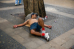 BRAZIL-10001, Man sleeping against tree in Brazil, São Paulo 2008