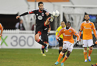 D.C. United Branko Boskovic (8) goes against Houston Dynamo midfielder Boniek Garcia (27) D.C. United tied The Houston Dynamo 1-1 but lost in the overall score 4-2 in the second leg of the Eastern Conference Championship at RFK Stadium, Sunday November 18, 2012.