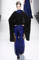 Model walks runway an EBONY SILK+ CASHMERE HANDLOOMED EVENING CARDIGAN WRAP.W/&quot;ONE THOUSAND NIGHTS &amp; ONE NIGHT BORDER, WITH.&quot;ONE THOUSAND NIGHTS &amp; ONE NIGHT&quot; SILK ORGANZA SWEEPING FLARE TROUSERS by Zang Toi, for the Zang Toi Spring 2012 My Dream Of North Africa Collection, during Mercedes-Benz Fashion Week Spring 2012.