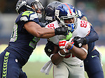 Seattle Seahawks linebacker K.J. Wright (50) and cornerback Tharold Simon (27) wraps up  New York Giants wide receiver Rueben Randle (82) at CenturyLink Field in Seattle, Washington on November 9, 2014. The Seahawks  beat the Giants 38-17.    ©2014. Jim Bryant Photo. All rights Reserved.
