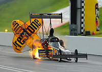Jun. 18, 2011; Bristol, TN, USA: NHRA top fuel dragster driver Troy Buff has a fire during qualifying for the Thunder Valley Nationals at Bristol Dragway. Mandatory Credit: Mark J. Rebilas-US PRESSWIR