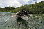West Papuan fishermen in their outrigger house boat