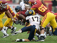 Chris Conte of California tackles C.J. Gable during the game at LA Memorial Coliseum in Los Angeles, California.  USC defeated California, 48-14.