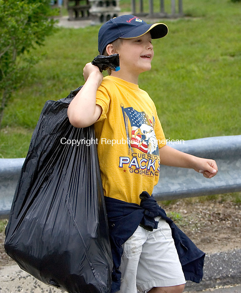 TORRINGTON CT. 06 June 2015-060615SV02-Aidan Scanlon, 9, of Goshen hauls a bag of trash from the river during a clean up of the Naugatuck River in Torrington Saturday. Scanlon was working with a group from Cub Scout troop 35 from Goshen.<br /> Steven Valenti Republican-American