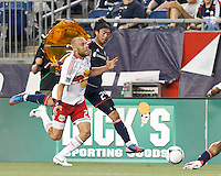 After clicking heels, New York Red Bulls midfielder Joel Lindpere (20) starts to go down. New England Revolution midfielder Lee Nguyen (24) continues for the ball. In a Major League Soccer (MLS) match, New England Revolution defeated New York Red Bulls, 2-0, at Gillette Stadium on July 8, 2012.