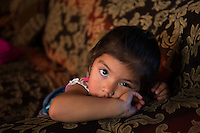 Two year old Irizuleica, at home in her trailer after visiting the food distribution center.