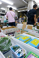 Irodori products on sale, Fruit and vegetable section, Tsukiji Fish Market, Tokyo, Japan, July 14, 2014.The Irodori Project is based in the mountain town of Kamikatsu, Tokushima Prefecture. Farmers - many of them elderly - grow leaves and flowers to use to decorate Japanese food in restaurants and hotels across the nation.