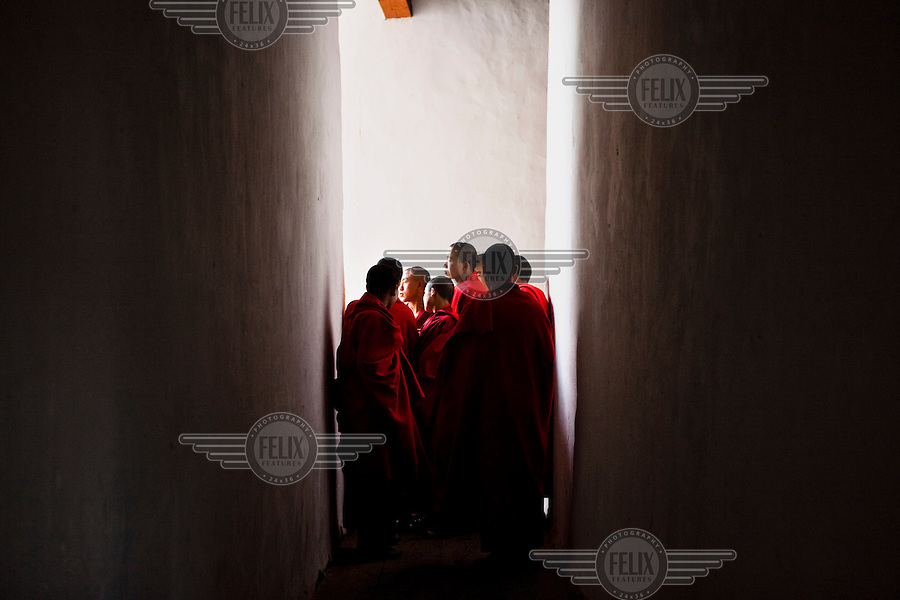 Buddhist monks seen at the ancient Punakha Dzong (fortress) in Punakha, Bhutan.