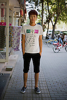 Wangziqi, a hairstylist, age 20, poses for a portrait in Beijing. Response to 'What does China mean to you?': 'It means the People's Republic of China!'  Response to 'What is your role in China's future?': 'To do something useful for my mother country.'