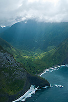 Sun rays beam down onto Wailau Valley and the northern shore of Moloka'i.