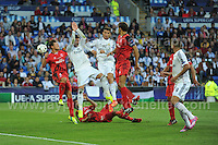 Cardiff City Stadium, Cardiff, South Wales - Tuesday 12th Aug 2014 - UEFA Super Cup Final - Real Madrid v Sevilla - <br /> <br /> A scramble for the ball in the Sevilla goal area. <br /> <br /> <br /> <br /> <br /> Photo by Jeff Thomas/Jeff Thomas Photography