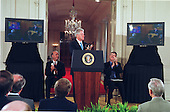 United States President Bill Clinton applauds the remarks of  British Prime Minister Tony Blair who spoke from London at the announcement of the completion of the first survey of the entire Human Genome at the White House in Washington, DC on June 26, 2000. Doctor J. Craig Venter, President and Chief Scientific Officer, Celera Genomics Corporation is seated at left and Doctor Francis Collins, Director, National Institutes of Health (NIH) is seated at right.<br /> Credit: Ron Sachs / CNP