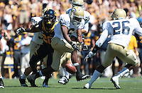 Isi Sofele forces the fumble of Elon Wyatt. The University of California Berkeley Golden Bears defeated the UC Davis Aggies 52-3 in their home opener at Memorial Stadium in Berkeley, California on September 4th, 2010.