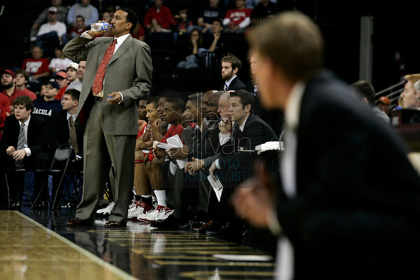 University of Georgia coach Dennis Felton (left) and Gonzaga University coach Mark Few during a basketball game at The Arena at Gwinnett Center in Duluth, Ga. on Saturday, Dec. 16, 2006. Georgia won 96-83.<br />