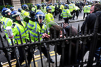 A policeman beats a demonstrator outside the Bank of England as thousands of protestors descended on the City of London ahead of the G20 summit of world leaders to express anger at the economic crisis, which many blame on the excesses of capitalism.