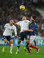 Clint Dempsey of team USA and Laurent Konscielny of team France (l-r) fight for the ball during the friendly match France against USA at the Stade de France in Paris, France on November 11th, 2011.