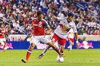 Quincy Amarikwa (18) of Toronto FC and Wilman Conde (2) of the New York Red Bulls. The New York Red Bulls defeated Toronto FC 4-1 during a Major League Soccer (MLS) match at Red Bull Arena in Harrison, NJ, on September 29, 2012.