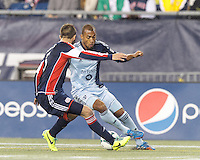 Sporting Kansas City forward Teal Bunbury (9) dribbles down the wing. In the first game of two-game aggregate total goals Major League Soccer (MLS) Eastern Conference Semifinal series, New England Revolution (dark blue) vs Sporting Kansas City (light blue), 2-1, at Gillette Stadium on November 2, 2013.