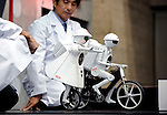 Seiko-chan, a mono-cycling humanoid robot, and seisaku-kun, a cycling humanoid robot both from Murata Manufacturing Co., are demonstrated in Japan8. ..Photographer: Robert Gilhooly