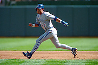 OAKLAND, CA - Roberto Alomar of the Toronto Blue Jays runs the bases during the 1992 American League Championship Series against the Oakland Athletics at the Oakland Coliseum in Oakland, California in 1992. Photo by Brad Mangin