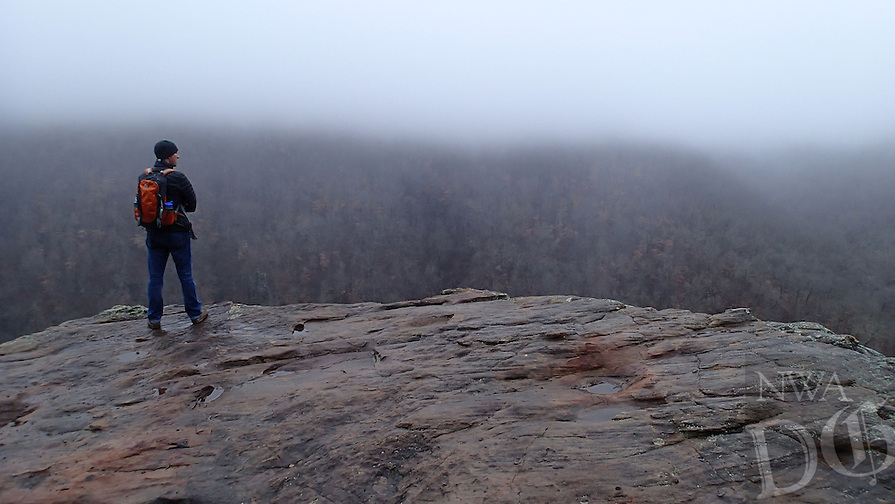 NWA Democrat-Gazette/FLIP PUTTHOFF <br /> A hiker takes in a foggy view Jan. 19 2017 at Hawksbill Crag.