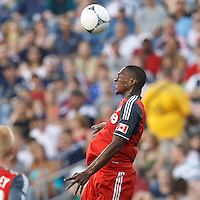 Toronto FC defender Doneil Henry (4) heads the ball. In a Major League Soccer (MLS) match, Toronto FC defeated New England Revolution, 1-0, at Gillette Stadium on July 14, 2012.