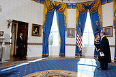 United States President Barack Obama (L) arrives to take the oath of office from U.S. Supreme Court Chief Justice John Roberts in the Blue Room of the White House in Washington, January 20, 2013..Credit: Larry Downing / Pool via CNP