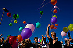 Balloons are released by family and friends, including his youngest sister Janis Schewe (right, blonde), at the memorial service for Sun City resident Monte Haag, who moved to Sun City in 2000 and died in December 2010. He died in a crash flying an ultralight plane outside of Sun City. The service was held in Social Hall No. 1 of the Bell Recreation Center and then balloons were released at the tennis courts Monte frequented in Sun City, Arizona December 11, 2010...2010 marks the 50th anniversary of Sun City, America's first retirement city that remains the largest today with more than 40,000 residents 55 and older.