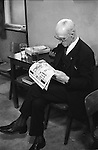 "An old age pensioner wearing his suit drinking alone and reading a newspaper, Sunday morning at Byker & St.Peters Working Men's Social Club Newcastle upon Tyne, Tyne and Wear northern England 1973. Typically he is wearing his ""Sunday best"" clothes."