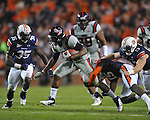 Ole Miss' Brandon Bolden (34) runs vs. Auburn linebacker Jonathan Evans (35), Auburn defensive back Neiko Thorpe (15), and Auburn defensive end Craig Sanders (13)  at Jordan-Hare Stadium in Auburn, Ala. on Saturday, October 29, 2011. .