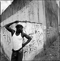 Luanda, Angola, May 20, 2006.Bairro Pescadores. Alcoolism is widespread among the fishermen who bring in fish harvested in heavily polluted and cholera infected waters. Between February and June 2006, more than 30000 people were infected with cholera in Angola's worse outbreak ever; more than 1300 died.