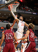 Nov 6, 2010; Charlottesville, VA, USA; Virginia Cavaliers f Mike Scott (23) shoots the ball over Roanoke College defenders Saturday afternoon in exhibition action at John Paul Jones Arena. The Virginia men's basketball team recorded an 82-50 victory over Roanoke College.