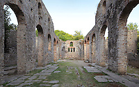 Nave and side aisles of the Great Basilica, 6th century AD, seat of the bishop, Butrint, Chaonia, Albania. The Basilica originally had 3 aisles separated by colonnades of columns and capitals reused from earlier buildings and a floor paved with mosaic. Butrint was founded by the Greek Chaonian tribe and was a port throughout Hellenistic and Roman times, when it was known as Buthrotum. It was ruled by the Byzantines and the Venetians and finally abandoned in the Middle Ages. The ruins at Butrint were listed as a UNESCO World Heritage Site in 1992. Picture by Manuel Cohen