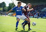 St Johnstone v Hearts...04.08.13 SPFL<br /> Chris Millar and Kevin McHattie<br /> Picture by Graeme Hart.<br /> Copyright Perthshire Picture Agency<br /> Tel: 01738 623350  Mobile: 07990 594431