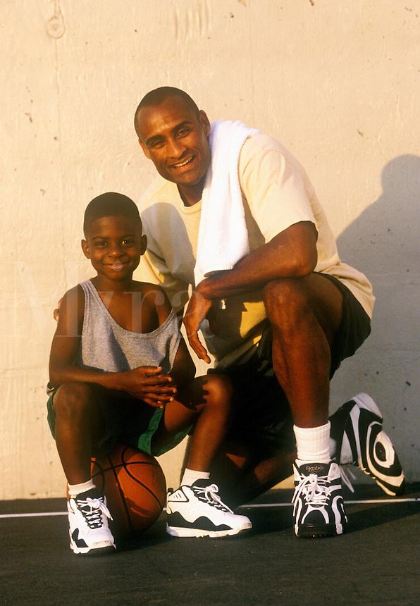 Father and son enjoy playing basketball.
