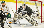 29 December 2014: Providence College Friar Goaltender Jon Gillies, a Junior from South Portland, Maine, watches a shot drift wide in third period action against the University of Vermont Catamounts during the deciding game of the annual TD Bank-Sheraton Catamount Cup Tournament at Gutterson Fieldhouse in Burlington, Vermont. Gillies and the Friars shut out the Catamounts 3-0 to win the 2014 Cup. Mandatory Credit: Ed Wolfstein Photo *** RAW (NEF) Image File Available ***