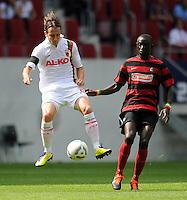 FUSSBALL   1. BUNDESLIGA  SAISON 2011/2012   1. Spieltag FC Augsburg - SC Freiburg            06.08.2011 Paul Verhaegh (li, FC Augsburg) gegen Papiss Demba Cisse (re, SC Freiburg)
