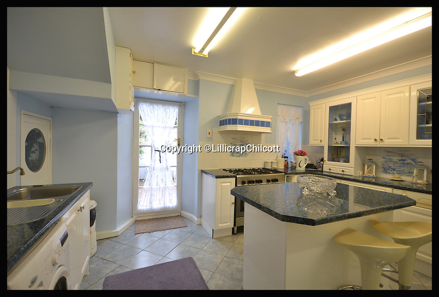 BNPS.co.uk (01202 558833)<br /> Pic: LillicrapChilcott/BNPS<br /> <br /> The kitchen.<br /> <br /> Next stop Spain!<br /> <br /> A rare chance to own the most southerly house in Britain nestled on a rocky outcrop overlooking the English Channel has arisen - but prospective buyers will have to rustle up &pound;575,000 to get their hands on it.<br /> <br /> The secluded two-bed terraced house would be ideal for those looking to be at one with nature - because it sits on the tip of Bass Point at The Lizard in Cornwall, the most southerly part of mainland Britain.<br /> <br /> Once a coastguard cottage, it offers sweeping 180 degree views of the rugged coastline and is so exposed to the elements its owners say sitting in the lounge feels like being out at sea.<br /> <br /> If you were to travel due south of the house the next land you would hit would be Santander in Spain.