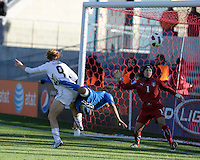 US midfielder Heather O'Reilly (9) takes a shot on Italian goalkeeper Anna Maria Picarelli (1) while being defended by defender Sara Gama (2).  The U.S. Women's National Team defeated Italy 1-0 at Toyota Park in Bridgeview, IL on November 27, 2010 to advance to the Women's World Cup in Germany.