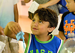 TRISTAN BISSOONDIAL, 5, of Bellmore, is holding blue slime he made during Science Exploration Moon Day, presented by Long Island Fringe Festival 5. There were many science projects and activities at the Tackapuahsa Museum and Preserve, the host of this family event. Behind Tristan is his brother TYLER BISSOONDIAL, 8, who made green slime.