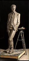 BNPS.co.uk (01202 558833)<br /> Pic: PhilYeomans/BNPS<br /> <br /> The return of the Thin White Duke...<br /> <br /> The world's first statue of David Bowie is taking shape in sculpter Andrew Sinclair's Devon studio.<br /> <br /> Ever since the music legend's death in January 2016 there has been a clamour for a fitting tribute of Bowie to be made.<br /> <br /> While his birthplace of Brixton, south London, has been cited as the most likely location for one it is actually Aylesbury in Buckinghamshire that will lay claim to having the very first statue of him.<br /> <br /> The market town was where Bowie played an experimental gig in 1971 to see if had the confidence to perform live and then a year later where his alter-ego of Ziggy Stardust was born.<br /> <br /> One half of the statue has been completed by artist Andrew Sinclair. It depicts a handsome Bowie in his 'Blue Suit' period in the 1990s.