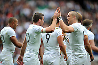 George Ford of England celebrates with team-mate Mike Brown. QBE International match between England and Ireland on September 5, 2015 at Twickenham Stadium in London, England. Photo by: Patrick Khachfe / Onside Images