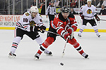 Mar 27; Newark, NJ, USA; New Jersey Devils left wing Ilya Kovalchuk (17) skates with the puck while being defended by Chicago Blackhawks right wing Patrick Kane (88) during the second period at the Prudential Center.