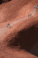 Sep 17, 2008 - Yulara, Northern Territory, Australia - Uluru, also referred to as Ayers Rock, is a large sandstone rock formation in the southern part of the Northern Territory, central Australia. It lies 335 km (208 mi) south west of the nearest large town, Alice Springs; 450 km (280 mi) by road. Kata Tjuta (The Olgas) and Uluru are the two major features of the Uluru - Kata Tjuta National Park. Uluru is sacred to the Pitjantjatjara and Yankunytjatjara, the Aboriginal people of the area. It has many springs, waterholes, rock caves and ancient paintings. Uluru is listed as a World Heritage Site.  Tourists making the controversial climb up Ayers Rock. (Credit Image: © Marianna Day Massey/ZUMA Press)