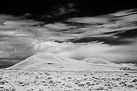 Infrared photograph of desert scrub and Badger Mountain as seen from West Richland, WA.  Fine art photography by Michael Kloth.