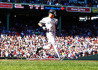Derek Jeter #2 of the New York Yankees runs to first base after recording his final hit of his career as an RBI single against the Boston Red Sox in the third inning at Fenway Park on September 27, 2014 in Boston, Massachusetts. (Photo by Jared Wickerham for the New York Daily News)
