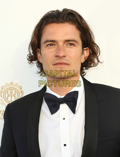 HOLLYWOOD, CA - JUNE 1: Orlando Bloom  attending the 2014 Huading Film Awards at Ricardo Montalban Theatre in Hollywood, California on June 1, 2014.   <br /> CAP/MPI/mpi99<br /> &copy;mpi99/MediaPunch/Capital Pictures