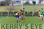 Liam Carey  Beaufort goes past Jonathan O'Sullivan Milltown Castlemaine during the Mid Kerry final in Killorglin on Sunday