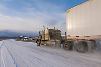 Semi tractor trailer travels the James Dalton Highway in Alaska's arctic.
