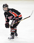 Maggie DiMasi (NU - 4) - The Northeastern University Huskies tied Boston University Terriers 3-3 in the 2011 Beanpot consolation game on Tuesday, February 15, 2011, at Conte Forum in Chestnut Hill, Massachusetts.